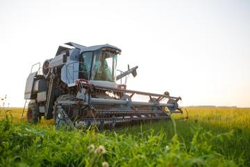 Image of combine harvester in field