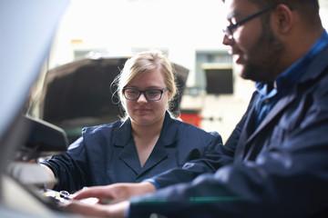 Students at car maintenance class