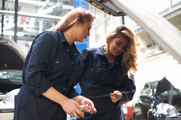 Students at car maintenance class