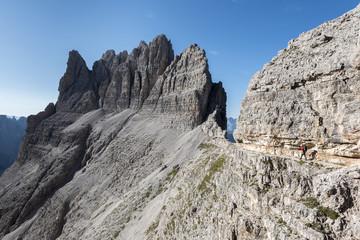 "Sesto / Sexten, province of Bolzano, Dolomites, South Tyrol, Italy. Climber on the via ferrata ""Passaporto"" at the Mount Paterno"