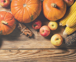 Autumn concept - pumpkins and other vegetables on wooden background