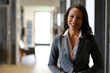 Portrait of businesswoman in office space, smiling