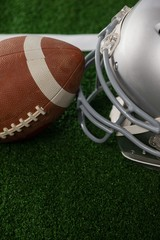 High angle view of American football by sports helmet