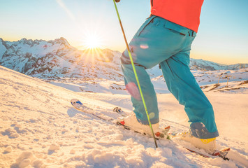 Skier having fun at sunset on top of the mountain