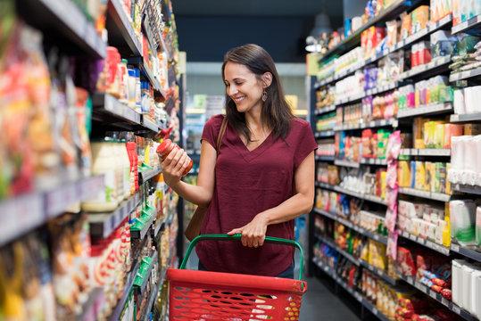 Smiling woman at supermarket