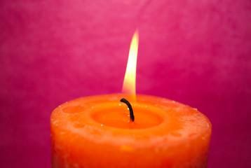 orange candle - pink background - esoterik