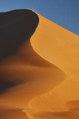 Sand dune shifting in wind