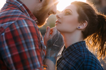 Romantic hipster couple kiss. Youth relationships background. Tender young people together closeup, gentle touch. Atmospheric backlight with focus on foreground, love concept
