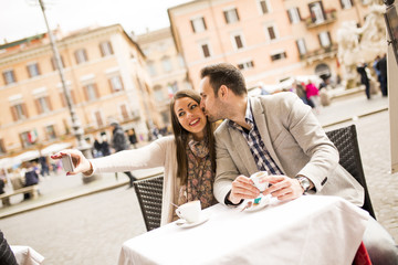 Couple taking selfie in the restaurant in Rome, Italy