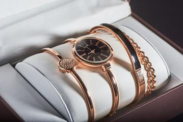 golden women's wrist watch on a white background