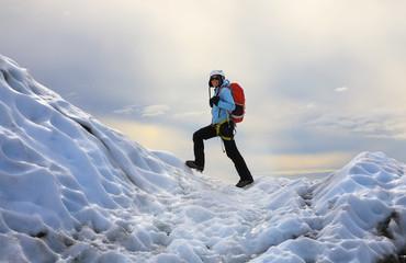 The girl climbing the glacier. Falljokull Glacier (Falling Glacier) in Iceland