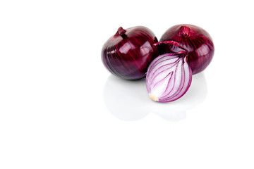 Red onion and half slice on white background with reflect.