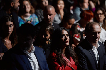 Salma Hayek and François Pinault sit in the first row during the front Christopher Kane Spring/Summer 2018 show at London Fashion Week