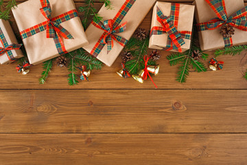 Presents for xmas or new year concept. Border of grey packages with red, green ribbons. Top view, copy space