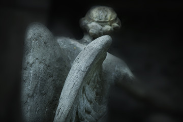 Fototapete - angel of death as a symbol of the end of life. Ancient statue. (Religion, eternal life, immortality, faith concept)