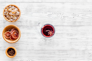 Celebrate new year winter evening with hot drink. Mulled wine or grog ingredients. White background top view. Space for text