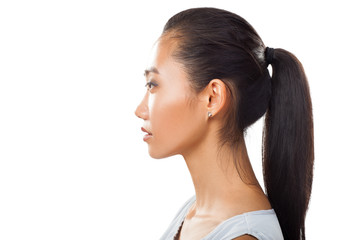 Closeup portrait of Asian young woman in profile with ponytail