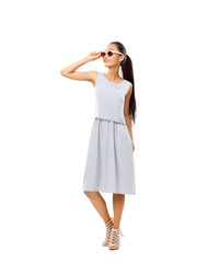 Studio portrait of full-length Asian beautiful woman with sunglasses