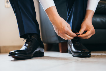 Groom lacing his shoes