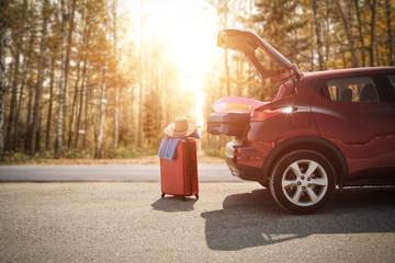 autumn car and suitcase  Fototapete