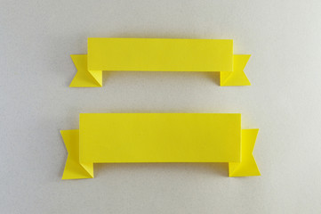 two strips of yellow paper