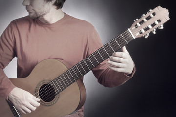 Classical guitar player. Classic guitarist playing acoustic guitar