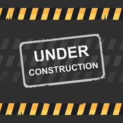 Under construction sign on dark background.