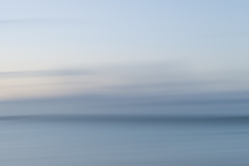 Abstract landscape image of vibrant blurred coastal sunrise