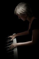 Tuinposter Muziek Piano player. Pianist playing piano concert