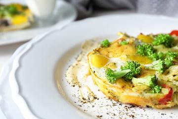 Tasty broccoli casserole on plate, closeup