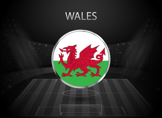 eps 10 vector Wales flag button isolated on black and white stadium background. Welsh national symbol in silver chrome ring. State logo sign for web, print. Original colors graphic design concept icon