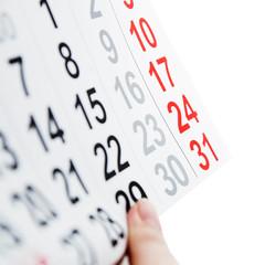 Desktop calendar sitting on desk showing december year of 2017