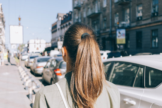 View from the back of a girl with brown hair