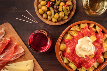 Tapas and wine. Patatas bravas, olives, jamon, cheese