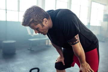 Fitness man tired after intense workout
