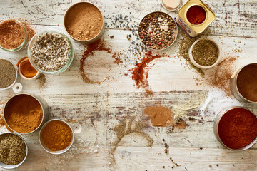 Variety of spices and seasoning on messy table