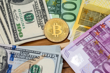bitcoin with dollar and euro banknote