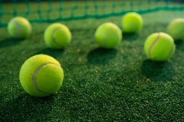 Close up of tennis balls on court