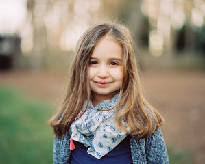 Portrait of a beautiful young girl with a scarf