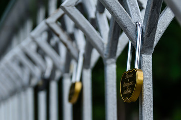 Love padlocks on a bridge in a city park