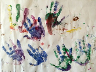 Hand prints on paper of a three year old child.