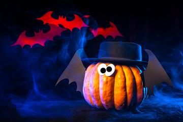Halloween. Pumpkin with bats. Red Vampires.