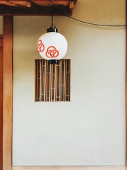 Japanese Aesthetics - Paper Lantern in Front of Bamboo Window