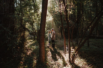 Couple Embracing in Forest