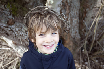 Boy wearing a crown of sticks