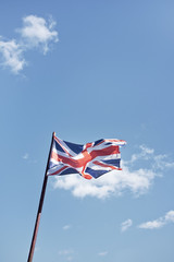 Union Jack flag against blue sky