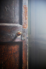 A wooden door and handle