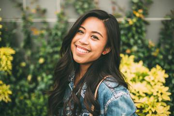 Smiling Young Woman Wearing Denim Jacket