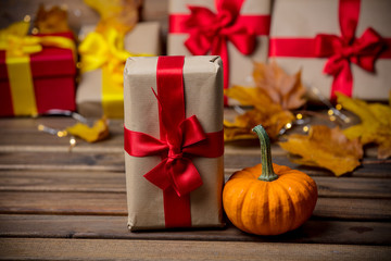 leaves and pumpkin with Halloween gift box