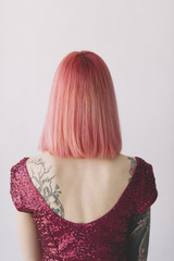 portrait of young woman with pink hair